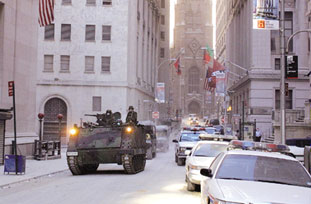 Military tank patrolling streets of New York near WTC